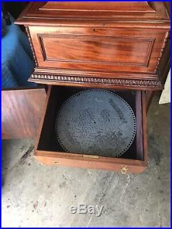 15 1/2 Regina Mahogany Double Comb Disc Music Box With Mahogany Stand