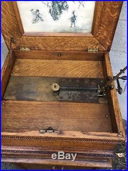 15 1/2 Regina Oak Double Comb Disc Music Box With Oak Cabinet