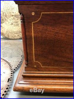 Regina 15.5 Mahogony Music Box with 27 Discs Inlaid & Carved Cabinet Works Great