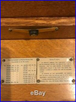 Regina double comb 15&1/2 light oak music box, base (custom made) and 40 discs