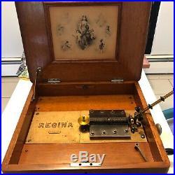 Regina music box 1889 with 23 music discs Model #44627
